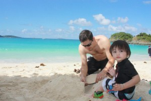 Building sand castle with dad.