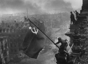 Berlin WWII - Raising a flag over the Reichstag - Picture courtesy of Wikipedia