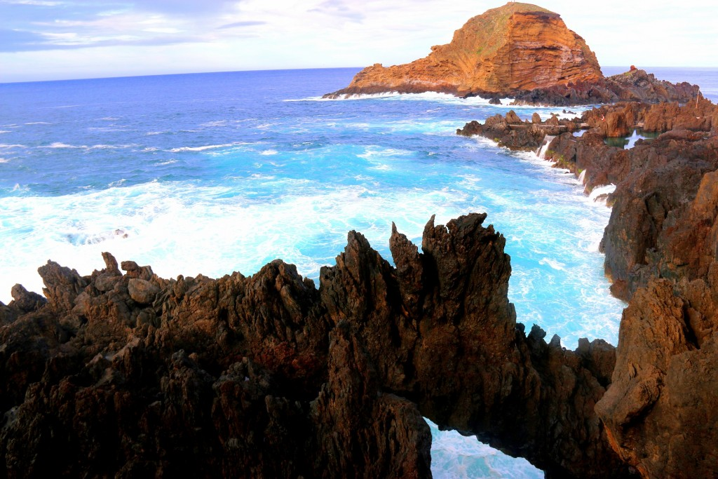 Lava rocks, deep blue crystal clear water and the waves makes this place not your ordinary chill location.