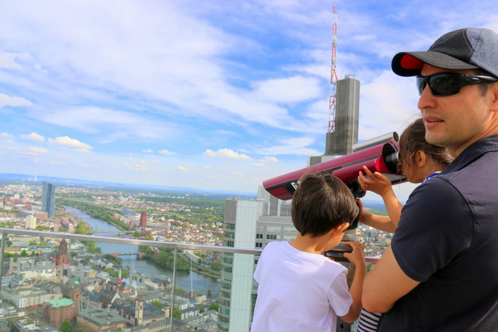 My husband showing the kids the view... Main Tower, Frankfurt Germany